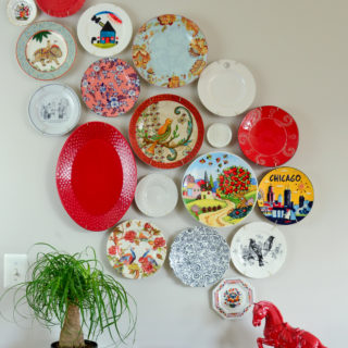 Mismatched plates from the thrift store and clearance aisle come together to create this beautiful asymmetrical plate wall